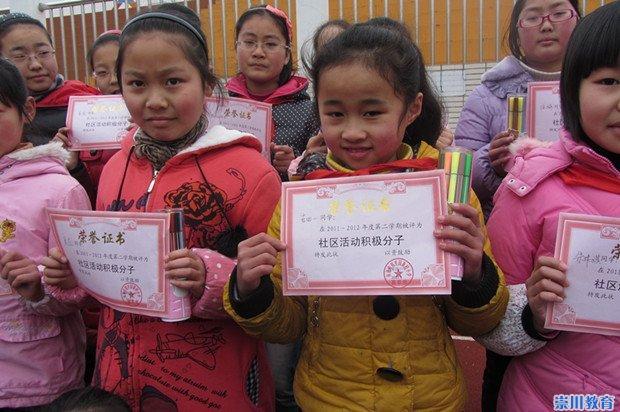 郭里园小学开展寒假社区实践活动积极分子的表原阳县二小第学图片
